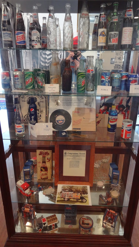 Various Pepsi cans and collectibles on display at the Pepsi Birthplace Store and Museum in New Bern, NC