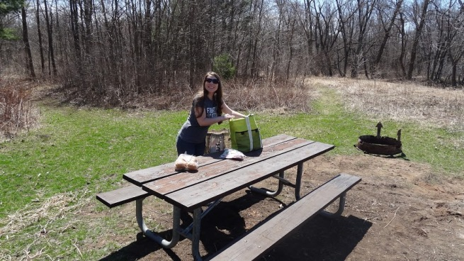 Breeah preps the picnic table. This was a great spot for lunch as it was right on the river bank. No signs in the area, but you can find it by taking the trail on the right (once you park at the Sandrock Cliffs lot)
