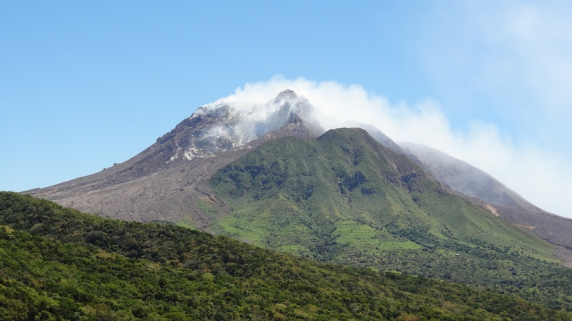 The now famous Soufriere Hills volcano, still spewing ash on a beautiful and clear March day.