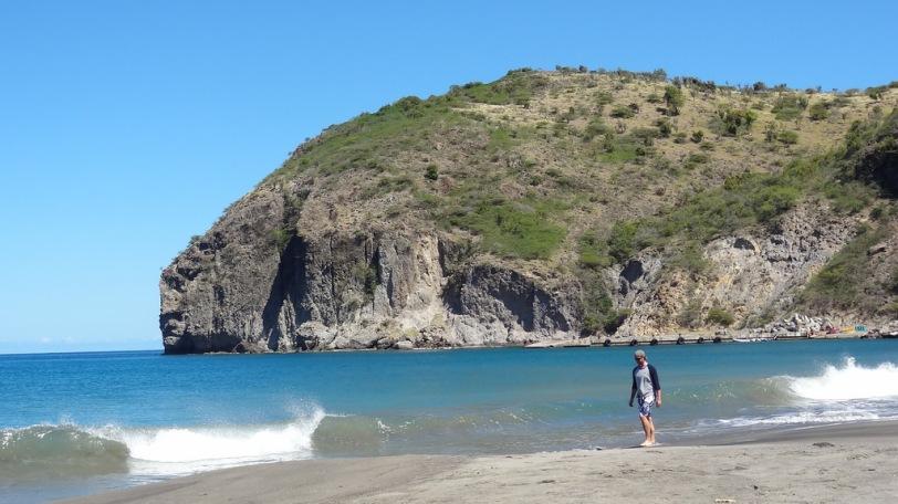The black sand beach at Little Bay