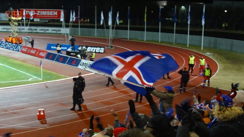 Fans waive the flag in support at the end of the match