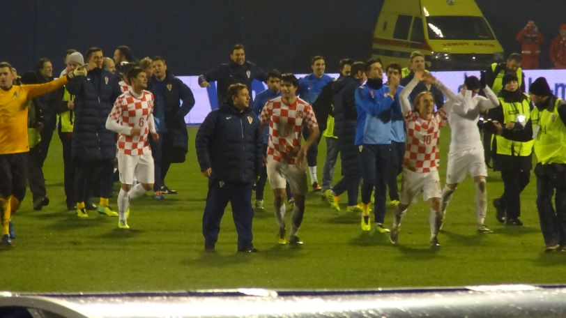 The Croatian team celebrates their World Cup berth. That's Real Madrid's Luka Modrić on the right, arguably Croatia's most well-known player.