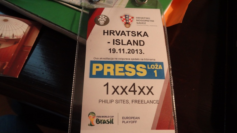 An official World Cup branded press pass.