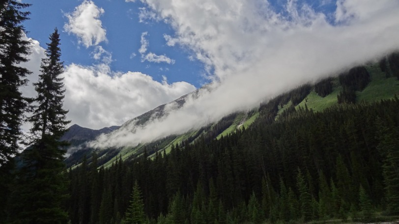 Clouds wrapping around the mountainside near Numa Falls in Kootenay National Park.