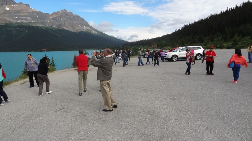 ...and here's all the tourists around me at Bow Lake trying to take similar shots. This is a pretty light crowd compared to some sights, but be prepared to deal with a few crowds, especially closer to Banff.