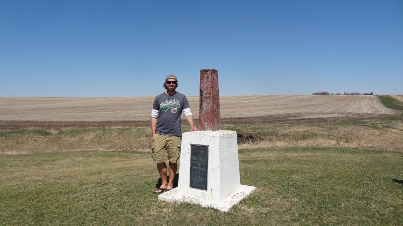 "Me standing on the ""dominant"" side of the tri-point, South Dakota. Minnesota lies to the north and east of the marker, while Iowa sits to the south and east. South Dakota takes up the entire side west of the marker."