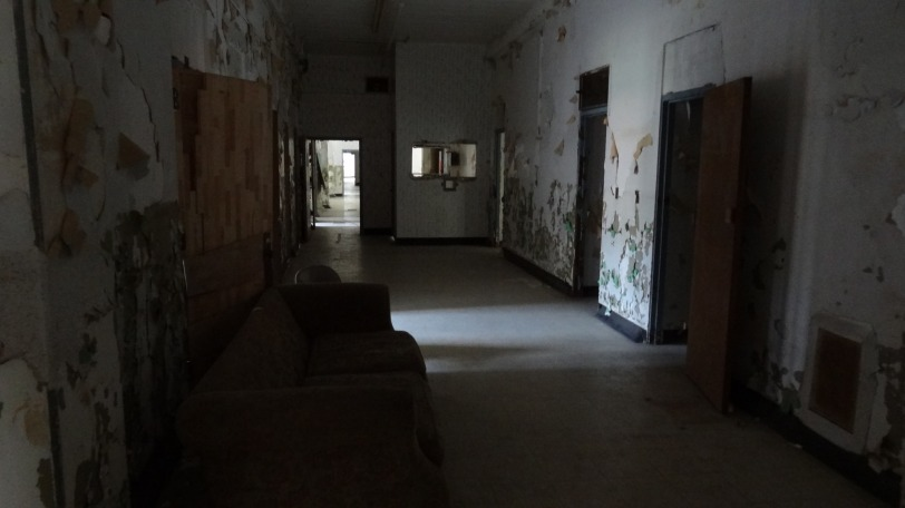 The first floor of the asylum, with a view towards the nursing station (window opening towards the back right)