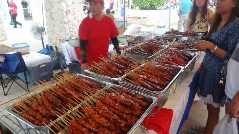 Time to feast at Saipan's Thursday night market. BBQ-on-a-stick for everyone!