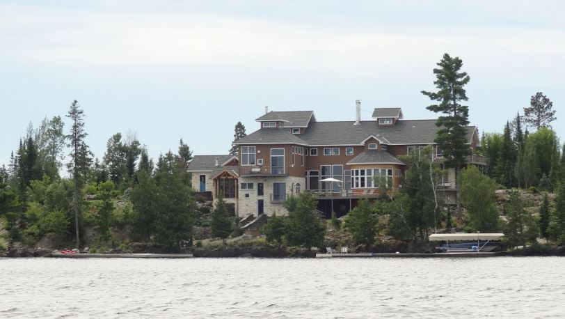 Huge houses adorn the Rainy Lake shoreline en route to the boundaries of the park